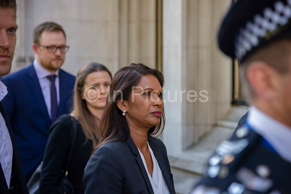 Businesswoman and campaigner Gina Miller, C who has launched legal proceedings against Prime Minister Boris Johnsons government over the suspension of parliament leaves  the Supreme Court with her legal team, surrounded by police officers and  her personal security on the final day of the hearing on 19th September 2019 in London, United Kingdom. Supreme Court judges will decide if Prime Minister Boris Johnson acted unlawfully in advising the Queen to prorogue parliament.