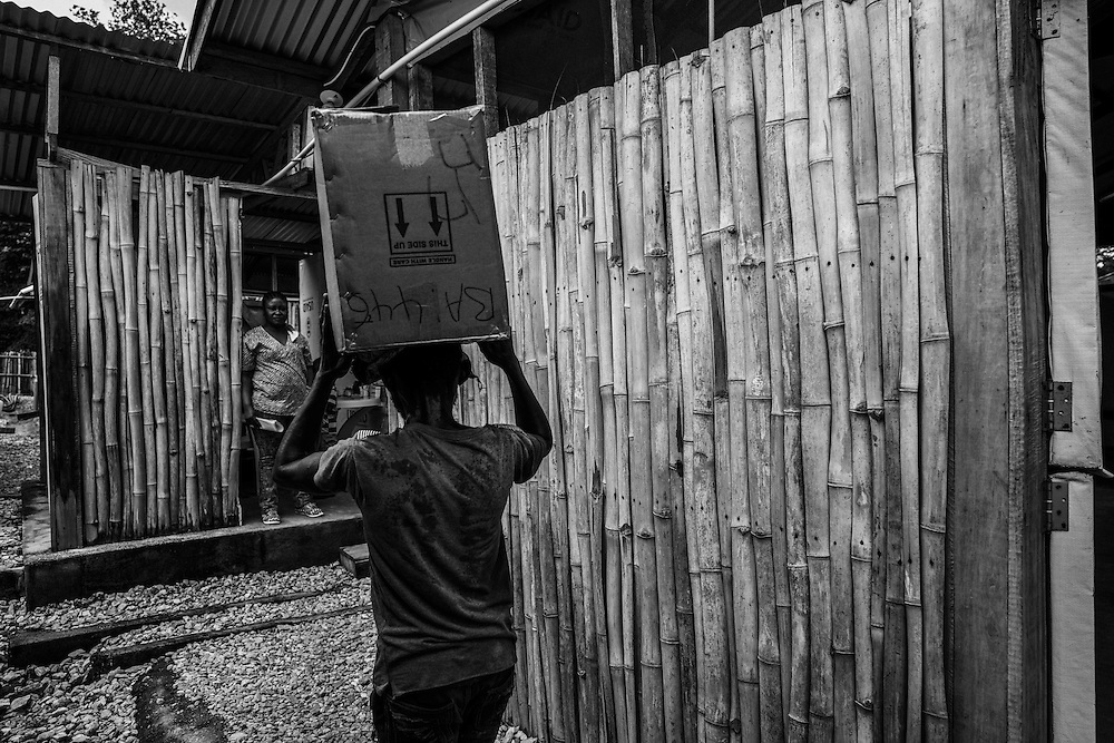 Medical supplies arrive for the only clinic in John Logan Town, Liberia.
