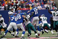 7 Dec 2008: Philadelphia Eagles linebacker Stewart Bradley #55 blocks a pass from New York Giants quarterback Eli Manning #10 during the game against the New York Giants on December 7th, 2008. The Eagles won 20-14 at Giants Stadium in East Rutherford, New Jersey. (Photo by Brian Garfinkel)