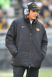 Nov 13, 2010; Columbia, MO, USA; Missouri Tigers head coach Gary Pinkel watches his team during a time out in the first half of the game against the Kansas State Wildcats at Memorial Stadium. Mandatory Credit: Denny Medley-US PRESSWIRE