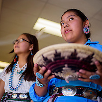 Elizabeth Yazzie and her classmates line up for the Navajo basket dance during the Indigenous Peoples' Day celebration at Six Directions School in Gallup Monday.