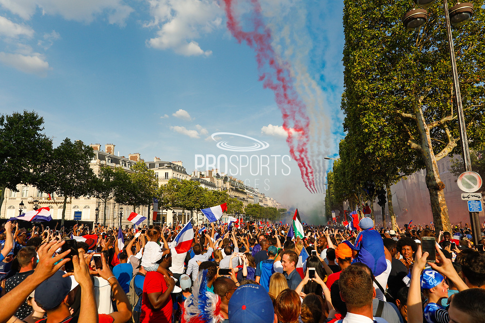 Crowd and flags for the Patrouille de France air plane during the parade of the team France on Champ-Elysées after winning the 2018 FIFA World Cup Russia on July 16, 2018 in Paris, France - Photo Frederic Le Floc'h / ProSportsImages / DPPI