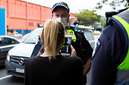 A woman live streams police as they order her to leave the area or risk arrest amid the third full day of the total lockdown of 9 housing commission high rise towers in North Melbourne and Flemington during COVID 19.After recording 191 COVID-19 cases overnight forcing Premier Daniel Andrews to announce today that all of metropolitan Melbourne along with one regional centre, Mitchell Shire will once more go back to stage three lockdowns from midnight Wednesday June 8. This comes as the residents of the housing commission towers in North Melbourne and Flemington finish their third day under extreme lockdown, despite only 27 cases being found in the towers. Members of the public gathered outside of the towers this afternoon in support of those trapped inside while riot police arrested two women for standing too close to the fence. While the women were later released, tensions are boiling over both in the towers and out. With 772 active cases in Victoria, NSW closed their border to Victoria effective at midnight tonight.