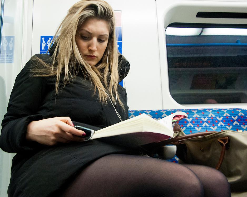 Female Londoner travelling on the London underground Network