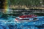 Sightseeing boat approaches Horseshoe Falls, Niagra Falls, Ontario, Canada.