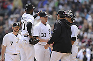 CHICAGO - APRIL 06:  Alexei Ramirez #10 pats Dylan Axelrod #33 of the Chicago White Sox on the head after Alexrod was removed from the game against the Seattle Mariners on April 06, 2013 at U.S. Cellular Field in Chicago, Illinois.  The White Sox defeated the Mariners 4-3.  (Photo by Ron Vesely)   Subject:  Dylan Axelrod; Alexei Ramirez