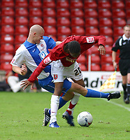 Photo: Dave Linney.<br />Walsall v Hartlepool United. Coca Cola League 2. 12/08/2006Hartlepools .Michael Lelson(L) gets in a heavy challenge on  Ishmel Demontagnac