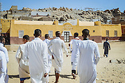 Friends following the groom to the port to start visiting other villages to invite the wedding guests