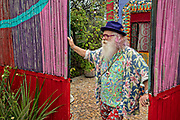 American artist Anado McLauchlin outside the Chapel of Jimmy Ray in his art compound Casa las Ranas September 28, 2017 in La Cieneguita, Mexico.