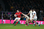 George North of Wales tries to break away from England's Mike Brown.  England v Wales, NatWest 6 nations 2018 championship match at Twickenham Stadium in Middlesex, England on Saturday 10th February 2018.<br /> pic by Andrew Orchard, Andrew Orchard sports photography