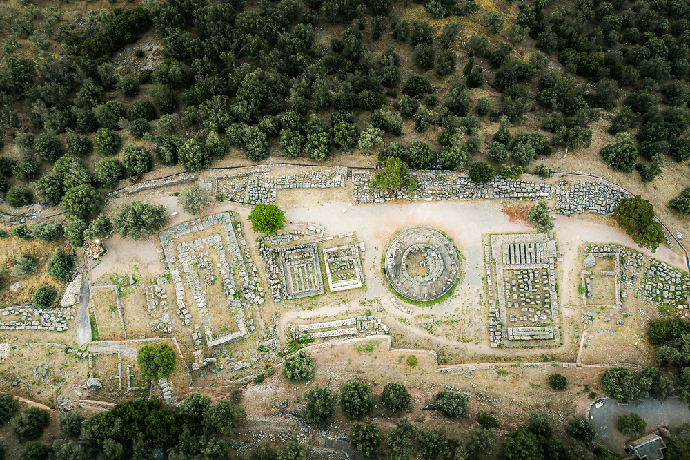 Ruins of the Archaiologikos Choros Delphon in the ancient Greek town of Delphi, Greece