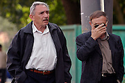Moscow, Russia, 12/08/2004..Scnes outside the court where former Yukos CEO Mikhail Khodorkovsky and business associate Platon Lebedev face charges of fraud, embezzlement and tax evasion. Mikhail Khodorkovsky's father Boris outside the court with a family friend hiding his face from the cameras.