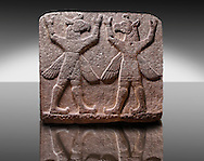 """Picture of Neo-Hittite orthostat describing the legend of Gilgamesh from Karkamis,, Turkey. Symetrical mythological Scene depicting """"Winged Griffin Demons"""", half men with birds heads & wings. Their hands are raised above their heads supposidly carrying the sky. An Ankara Museum of Anatolian Civilizations exhibit."""