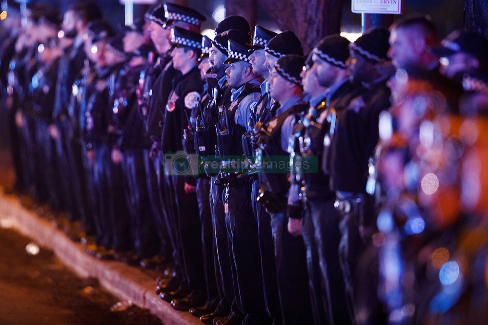 December 18, 2018 - Chicago, Illinois, USA - Members of the police department wait for the bodies of two officers who were killed Monday night while pursuing a suspect and struck by a South Shore train near 103rd Street and Dauphin Avenue to arrive at the medical examiner's office in Chicago, Ill. (Credit Image: © Armando L. Sanchez/Chicago Tribune/TNS via ZUMA Wire)