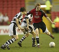 Photo: Aidan Ellis.<br /> Darlington v Swansea City. The FA Cup. 02/12/2006.<br /> Swansea's Dennis Lawrence takes on the darlo defence