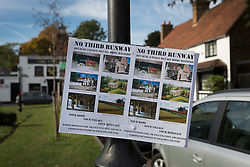 """© Licensed to London News Pictures. 27/10/2016. London, UK. A sign posted on a lamp post in the village of Harmondsworth near Heathrow Airport highlights local opposition to a third runway. The government has announced that a third runway will be built at the United Kingdom's busiest airport. The Cabinet are divided - with Foreign Secretary Boris Johnson saying that the project is """"undeliverable"""". Conservative MP for Richmond Zac Goldsmith has resigned. Photo credit: Peter Macdiarmid/LNP"""