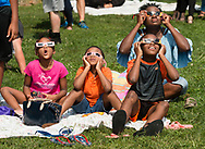 Middletown, New York - A family uses eclipse glasses to watch a partial solar eclipse on Alumni Green at SUNY Orange on Aug. 21, 2017.