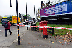 © Licensed to London News Pictures. 16/11/2012. Streatham, UK The fire took place behind an advertising hoarding. Two people have died and another is in hospital with burns after a fire on wasteland in south London. Firefighters were called to the scene in Streatham High Road, Streatham, just after 02:20 GMT. Two bodies were found at the scene and a third person was taken to hospital for treatment. Crews took just over an hour to bring the fire under control. The incident is being investigated by the London Fire Brigade and the Metropolitan Police. Photo credit : Stephen Simpson/LNP