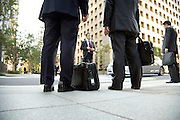businesspeople waiting to meet up with an other businessman