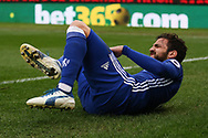 Cesc Fabregas of Chelsea reacts and holds his leg in pain after taking a knock.Premier league match, Stoke City v Chelsea at the Bet365 Stadium in Stoke on Trent, Staffs on Saturday 18th March 2017.<br /> pic by Andrew Orchard, Andrew Orchard sports photography.