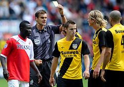 15-08-2010 VOETBAL: UTRECHT - NAC: UTRECHT<br /> FC Utrecht beats NAC, 3-1 / Referee Braanhaar show the yellow card<br /> ©2010-WWW.FOTOHOOGENDOORN.NL