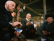 Anthropologist Ted Callahan having food with the Khan family, where he spent a whole winter to study the Afghan Kyrgyz community. Qyzyl Qorum camp.