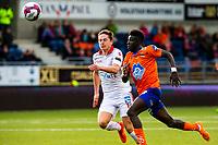 1. divisjon fotball 2018: Aalesund - Levanger (4-0). Aalesunds Pape Habib Gueye (t.h.) i løpsduell med Håvard Kleven Lorentsen i kampen i 1. divisjon i fotball mellom Aalesund og Levanger på Color Line Stadion.