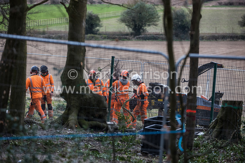 Wendover, UK. 9th April, 2021. Tree surgeons put branches into a wood chipper machine during tree felling operations for the HS2 high-speed rail link in Jones Hill Wood, ancient woodland said to have inspired Roald Dahl. Tree felling work began this week, in spite of the presence of resting places and/or breeding sites for pipistrelle, barbastelle, noctule, brown long-eared and natterer's bats, following the issue by Natural England of a bat licence to HS2's contractors on 30th March.