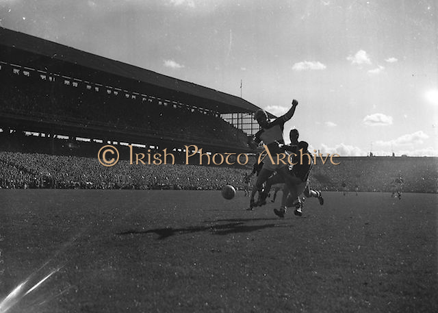 Player kicks ball towards goal<br /> during the All Ireland Senior Gaelic Football Final Down v. Offaly in Croke Park on the 24th September 1961.