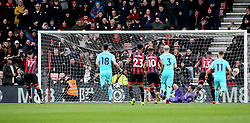 AFC Bournemouth's Joshua King (left) scores his side's first goal of the game from the penalty spot during the Premier League match at the Vitality Stadium, Bournemouth.