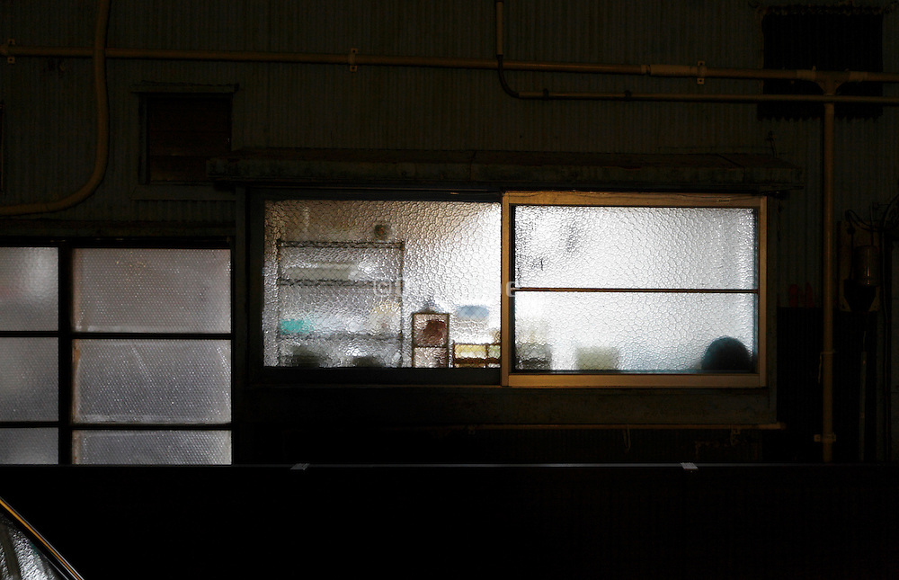 from inside lighted up window of a residential house Japan