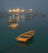 Saint Ives Harbour in Cornwall on the South West Coast of England on a misty foggy evening with the boats gently moving in calm water with the Village in the background. Limited Editions of 17