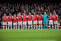 Football - 2019 / 2020 Premier League - Arsenal vs. Wolverhampton Wanderers<br /> <br /> The Arsenal team form up as they observe a minutes silence at The Emirates Stadium.<br /> <br /> COLORSPORT/DANIEL BEARHAM
