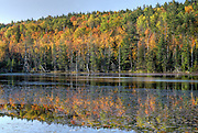 Adirondacks, NY.<br /> On this day I was fortunate that the sun didn't blow out the cloudless sky and brighter, advanced foliage before it got high enough above the ridges behind me to light the entire scene.