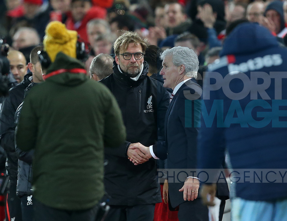 Liverpool's Jurgen Klopp shakes hands with Stoke's Mark Hughes during the Premier League match at Anfield Stadium, Liverpool. Picture date December 27th, 2016 Pic David Klein/Sportimage