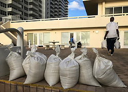 One of the disadvantages of beach living is facing major hurricanes. One of the advantages is plenty of sand for do-it-yourself sandbags. Workers at the Atlantic Ocean Club on Galt Ocean Drive in Fort Lauderdale finish protecting the building with the sand they were shoveling from the beach Friday morning Sept. 8, 2017. (Photo by Taimy Alvarez/Sun Sentinel/TNS/Sipa USA)<br />SOUTH FLORIDA OUT; NO MAGS; NO SALES; NO INTERNET; NO TV