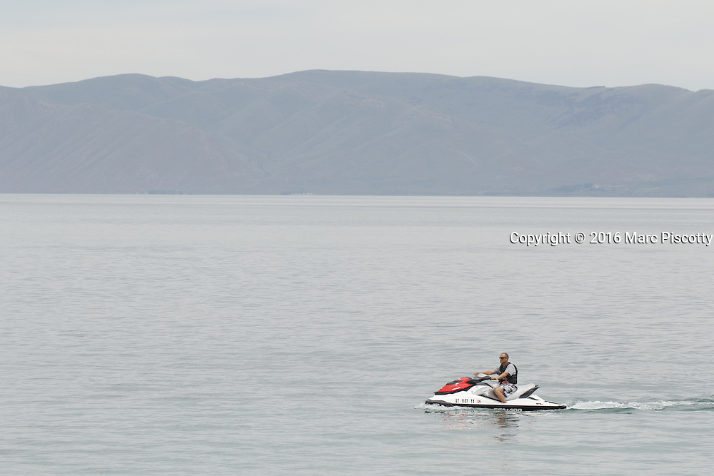 """SHOT 6/10/16 12:34:44 PM - Bear Lake is a natural freshwater lake on the Utah-Idaho border in the Western United States. About 109 square miles in size, it is split about equally between the two states. The lake has been called the """"Caribbean of the Rockies"""" for its unique turquoise-blue color, which is due to the reflection of calcium carbonate (limestone) deposits suspended in the lake. The lake is a popular destination for tourists and sports enthusiasts, and the surrounding valley has gained a reputation for having high-quality raspberries. (Photo by Marc Piscotty / © 2016)"""