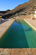 Swimming pool at tourist accommodation, Los Presillas Bajas, Cabo de Gata natural park, Almeria, Spain