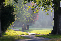 © Licensed to London News Pictures. 07/09/2021. London, UK. Walkers enjoy a warm misty morning in Chestnuts Park, north London as the mini heatwave continues in London. According to the Met office, temperatures over 28 degree Celsius are forecast today in London and the South East of England. Photo credit: Dinendra Haria/LNP