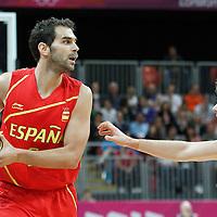 31 July 2012: Spain Jose Calderon looks to pass the ball over Australia Matt Dellavedova during the 82-70 Spain victory over Australia, during the men's basketball preliminary, at the Basketball Arena, in London, Great Britain.