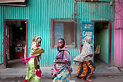 Colorful women shopping. The side streets near the Mahamoud Harbi (former Place Arthur Rimbaud), the heart of Djibouti where the main market is based and buses come and go out of Djibouti mainly towards Ethiopia...The geostrategical and geopolitical importance of the Republic of Djibouti, located on the Horn of Africa, by the Red Sea and the Gulf of Aden, and bordered by Eritrea, Ethiopia and Somalia.