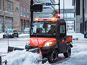 11 NOVEMBERS 2019 - DES MOINES, IOWA: A small snow plow on a sidewalk in downtown Des Moines Monday morning. About three inches of snow fell in the Des Moines area Sunday night into Monday morning snarling the Monday morning rush hour and delaying central Iowa schools by about two hours.       PHOTO BY JACK KURTZ
