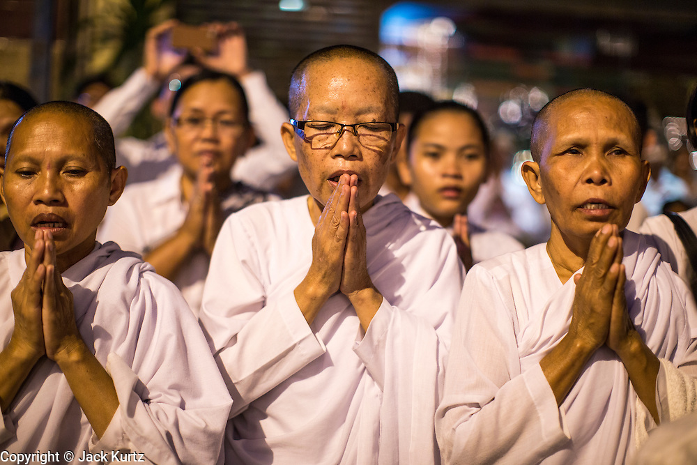 """03 FEBRUARY 2013 - PHNOM PENH, CAMBODIA:   Cambodian women pray during the final Buddhist chanting service for former Cambodian King Norodom Sihanouk in the crematorium built for the King's funeral at the National Museum in Phnom Penh. Norodom Sihanouk (31 October 1922- 15 October 2012) was the King of Cambodia from 1941 to 1955 and again from 1993 to 2004. He was the effective ruler of Cambodia from 1953 to 1970. After his second abdication in 2004, he was given the honorific of """"The King-Father of Cambodia."""" He served as puppet head of state for the Khmer Rouge government in 1975-1976, before going into exile. Sihanouk's actual period of effective rule over Cambodia was from 9 November 1953, when Cambodia gained its independence from France, until 18 March 1970, when General Lon Nol and the National Assembly deposed him. Upon his final abdication in 2004, the Cambodian throne council appointed Norodom Sihamoni, one of Sihanouk's sons, as the new king. Sihanouk died in Beijing, China, where he was receiving medical care, on Oct. 15, 2012. His cremation will take place on Feb. 4, 2013. Over a million people are expected to attend the service.   PHOTO BY JACK KURTZ"""