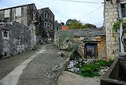 Deserted and derelict stone houses, village of Zrnovo, island of Korcula, Croatia