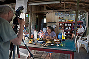 Peter Menzel, photojournalist and co-author of the book What I Eat: Around the World in 80 Diets photographs rancher's wife Solange Da Silva Correia at her home  near Manacapuru, Brazil. (Solange Da Silva Correia is featured in the book What I Eat: Around the World in 80 Diets.) MODEL RELEASED. PJM