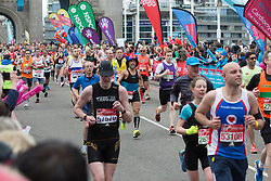 © Licensed to London News Pictures. 24/04/2016. London, UK. Fancy dress and mass runners run over Tower Bridge at the halfway point of the 2016 London Marathon.  Photo credit : Vickie Flores/LNP