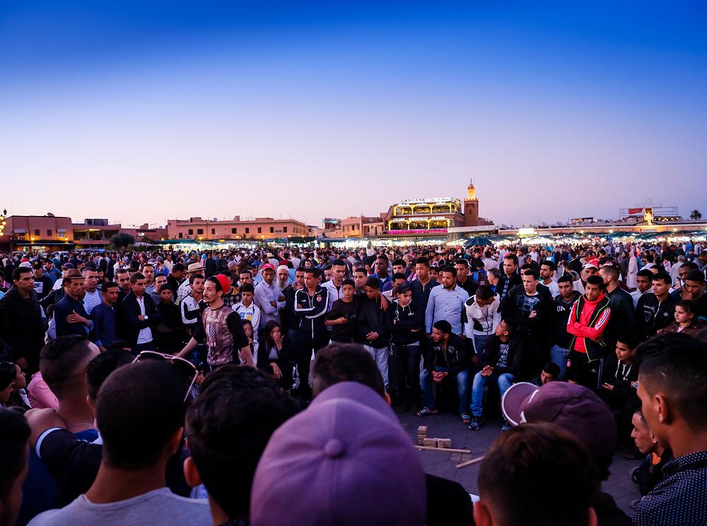 MARRAKESH, MOROCCO - CIRCA APRIL 2018: People gathering in Jemaa el-Fnaa, Marrakesh