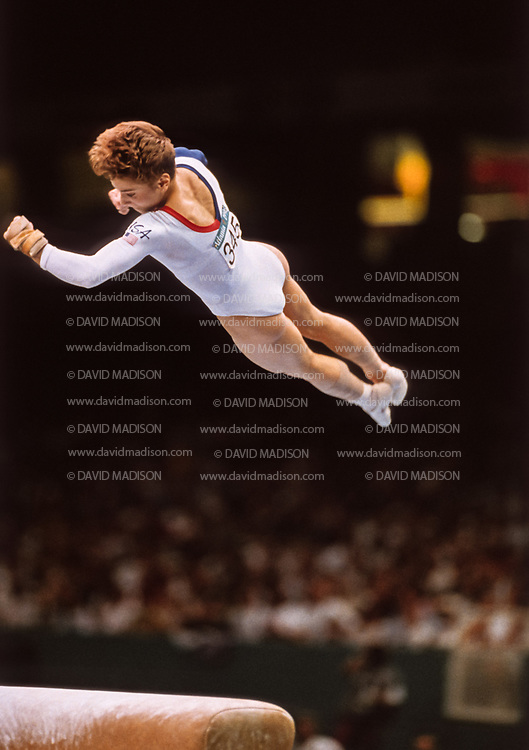 ATLANTA - JULY 23:  Kerri Strug of the United States performs a vault during the team competition of the Women's Gymnastics event of the 1996 Summer Olympic Games held on July 23, 1996 in the Georgia Dome in Atlanta, Georgia.  Strug was part of the gold medal winning USA Women's team, nicknamed the Magnificent Seven.  (Photo by David Madison/Getty Images)