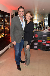 KATIE DERHAM and her husband JOHN VINCENT at the Costa Book Awards 2013 held at Quaglino's, 16 Bury Street, London on 28th January 2014.