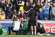 Oxford United midfielder Cameron Brannagan (8) receives treatment on the pitch during the EFL Sky Bet League 1 match between Wycombe Wanderers and Oxford United at Adams Park, High Wycombe, England on 15 September 2018.